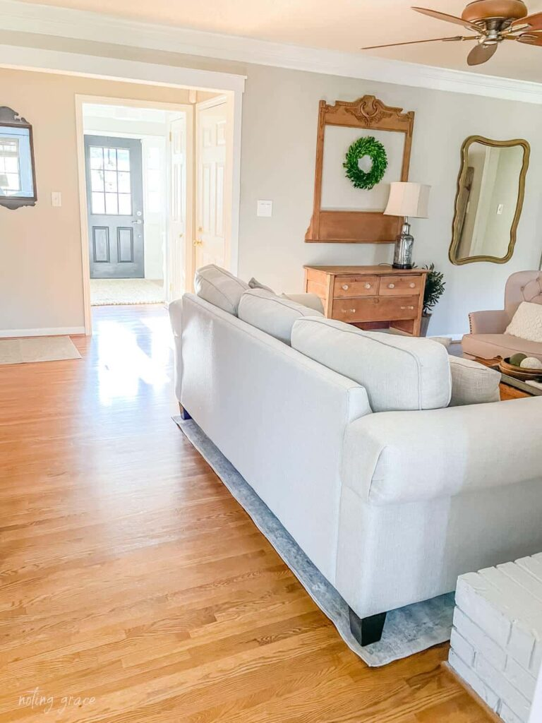 We needed to let more light shine in to our living room and there was just one obstacle keeping that from happening. This wall in our entryway needed to go! Here's how to remove an interior wall.