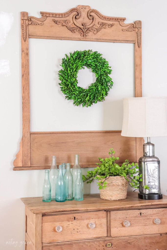Vintage dresser mirror frame with a wreath in the center