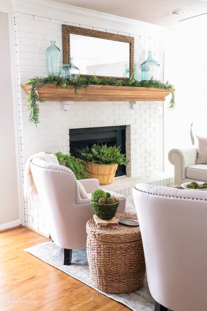 White painted fireplace with vintage mirror over the mantel