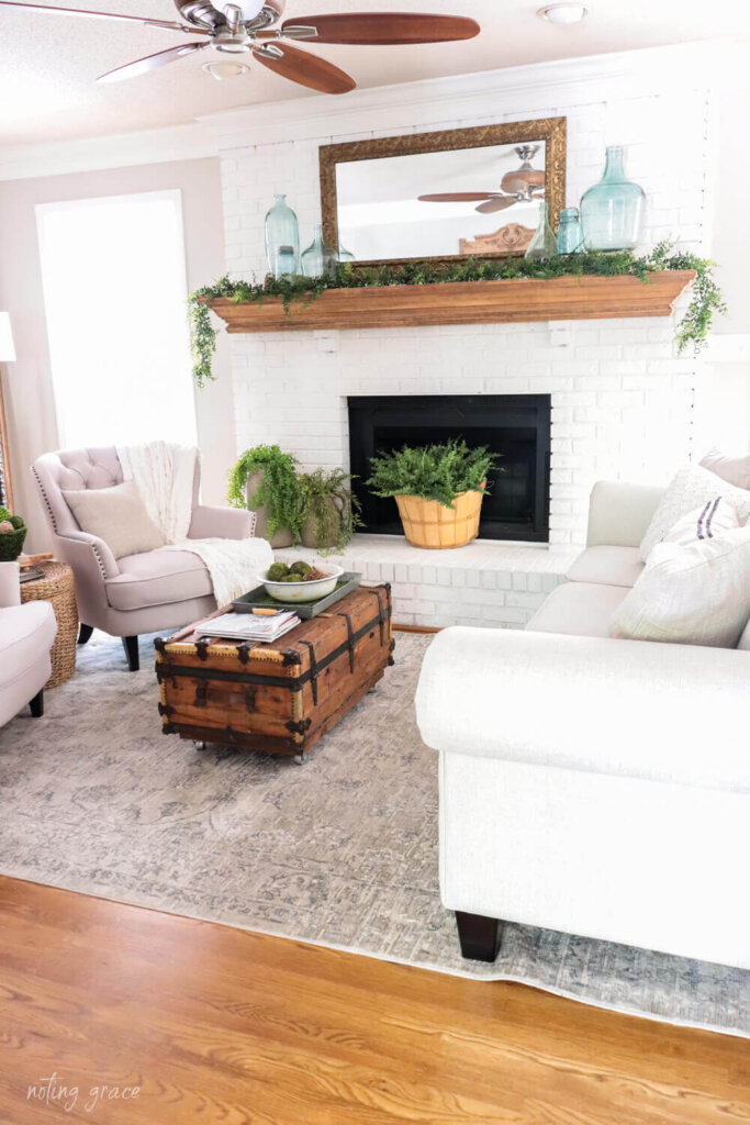 white painted fireplace with summer styled mantel