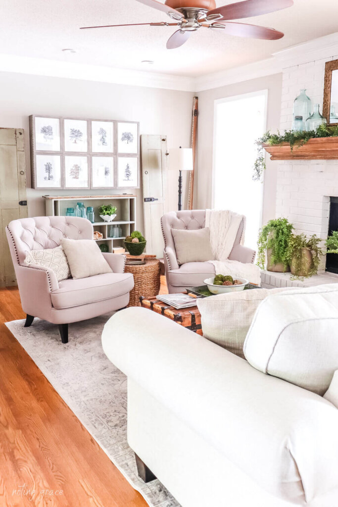 Living room with 2 tufted armchairs near a fireplace
