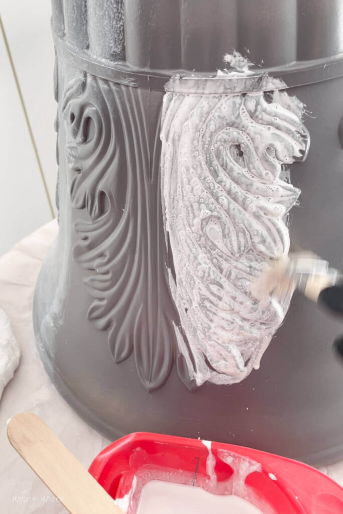 white paint over a gray spray painted plastic planter