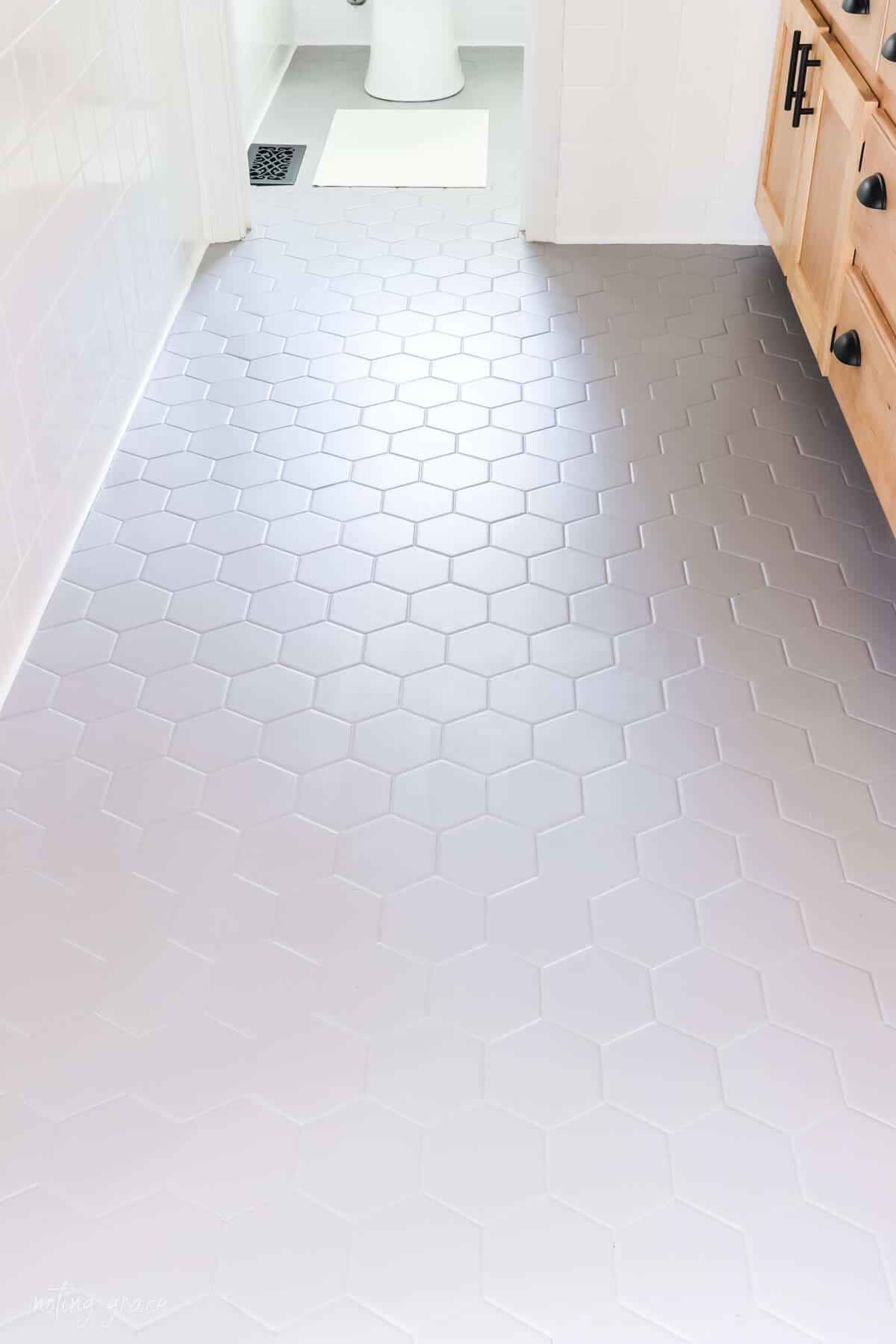 Overhead picture of hexagon bathroom floor tile painted gray