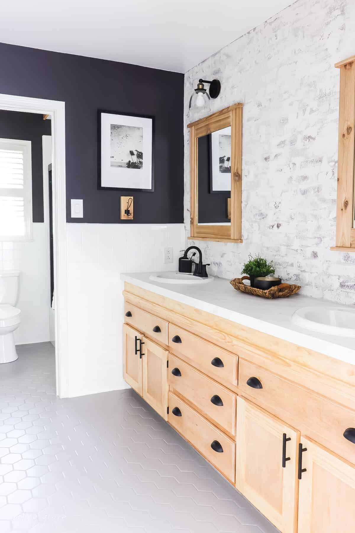 Changed bathrooms tiles for $150 bucks with white painted tile walls with gray painted hexagon tile floor with black painted walls and cedar wood elements.