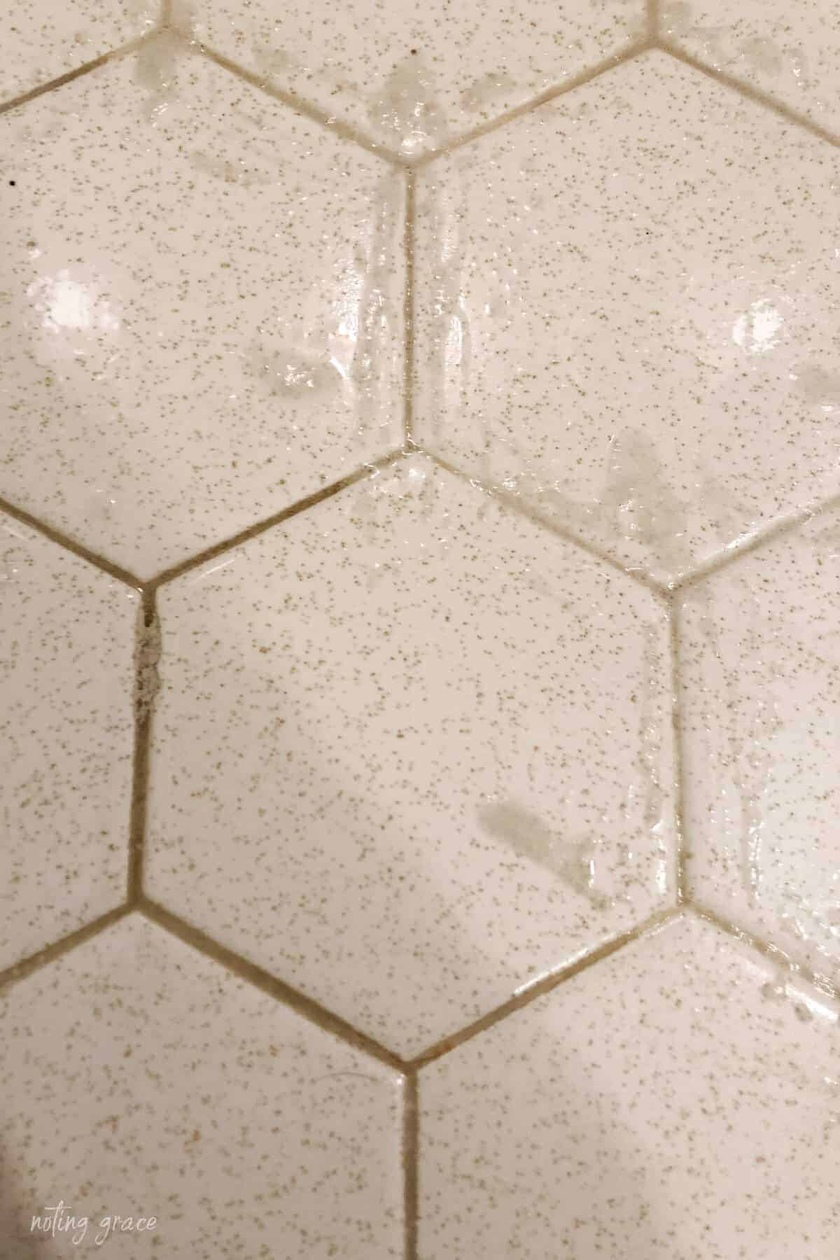 Close up of cleaning floor grout