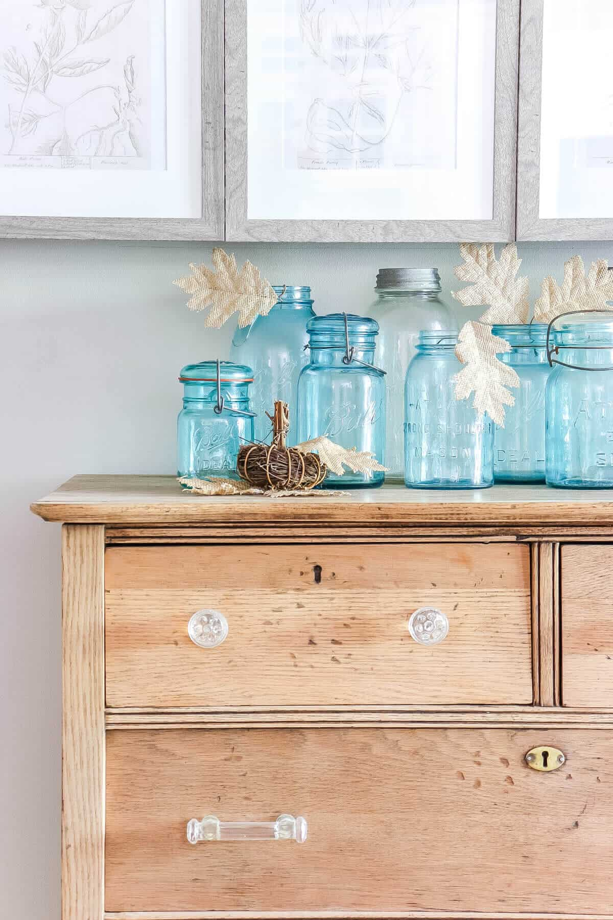 blue ball jars with burlap fall leaves
