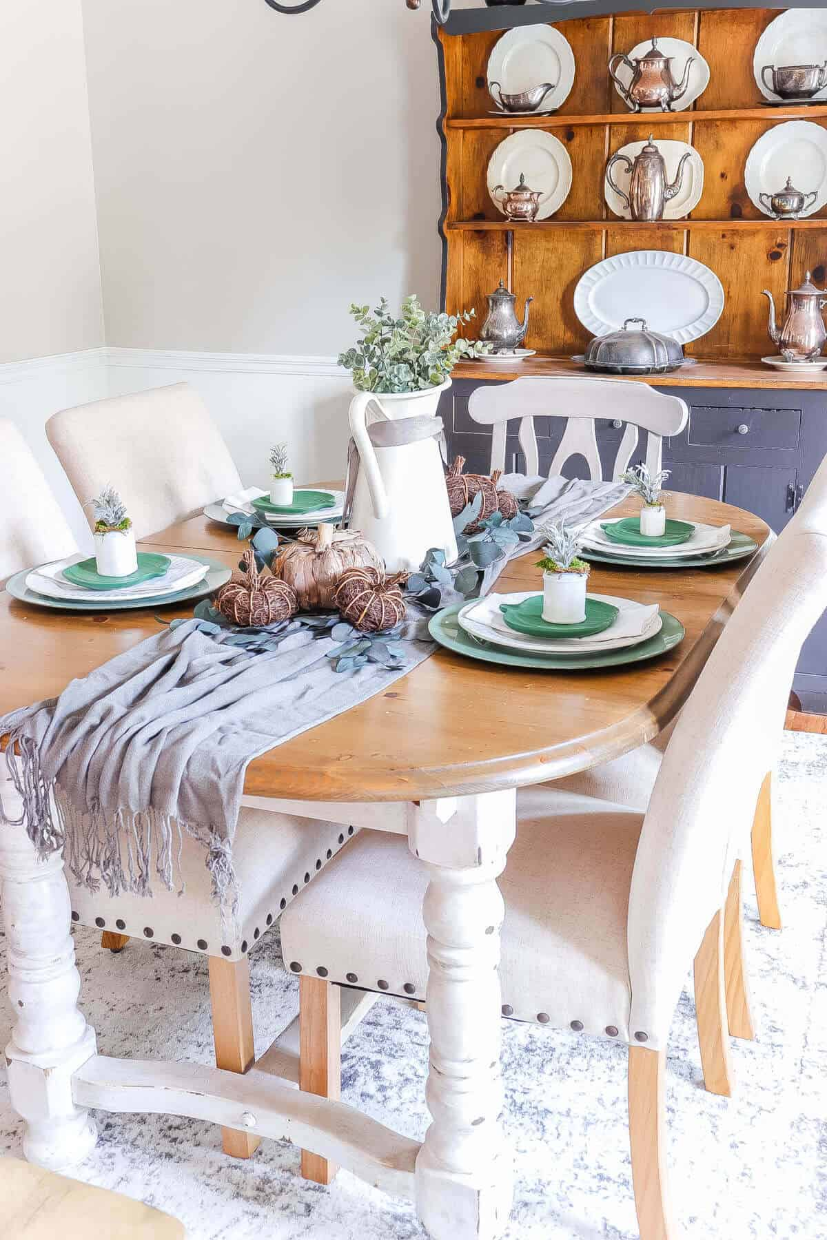 simple fall tablescape with gray runner and green pumpkin plates