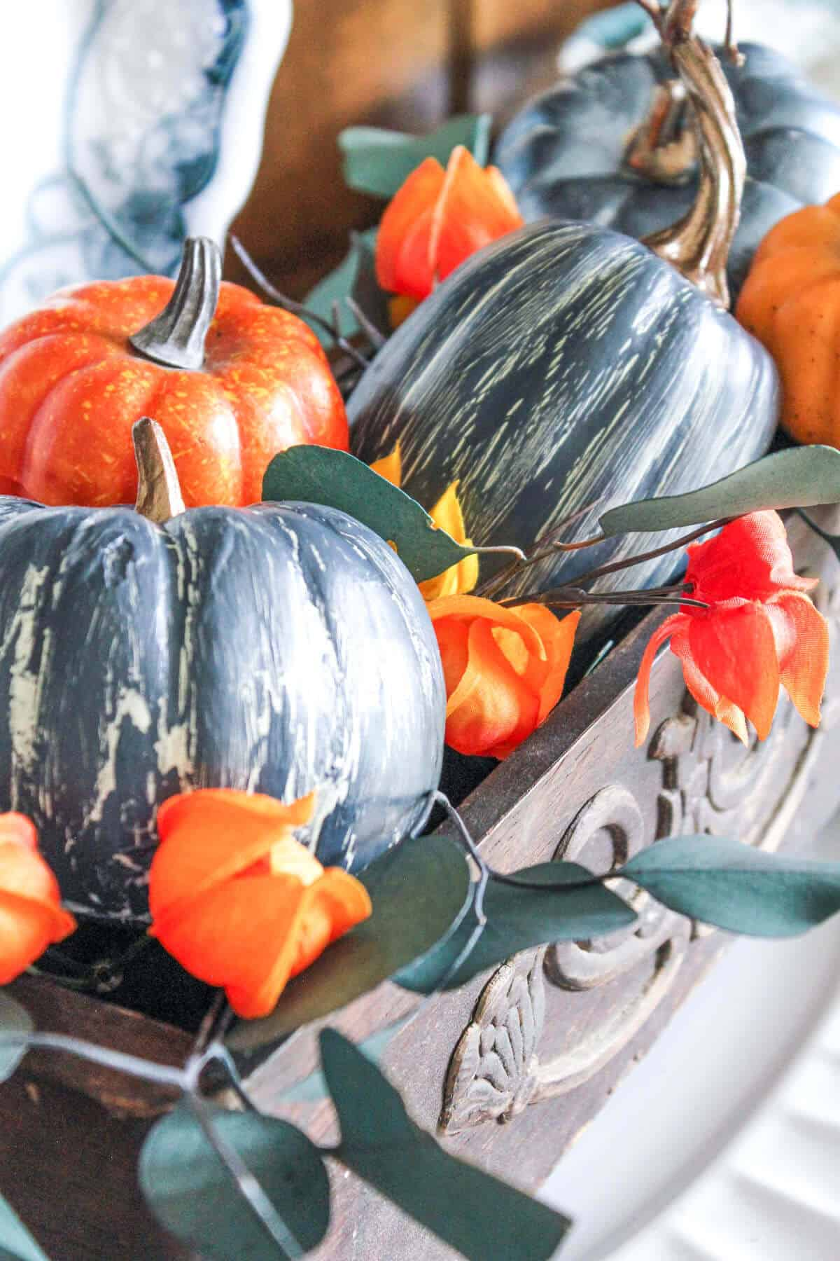 blue crackle painted pumpkins and orange pumpkins in a wooden carved box