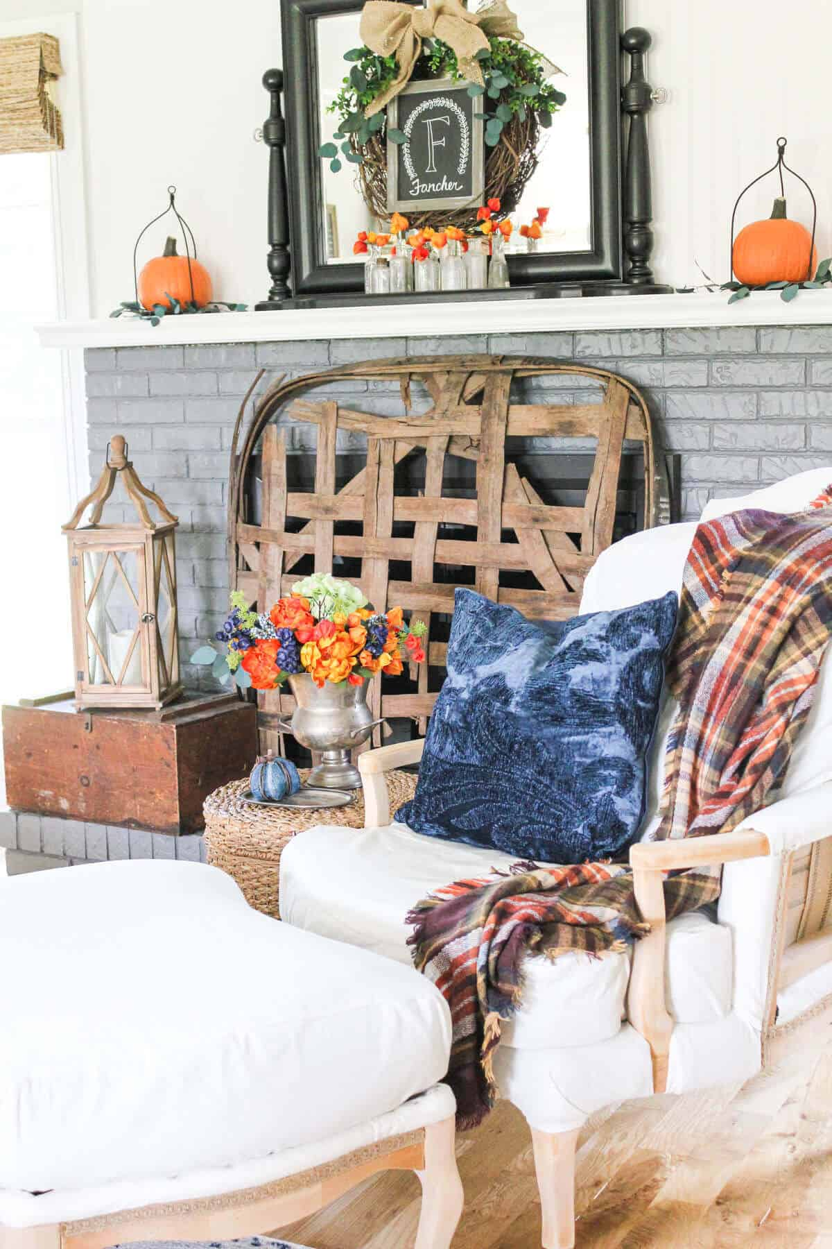 fall mantel with blue and orange decor
