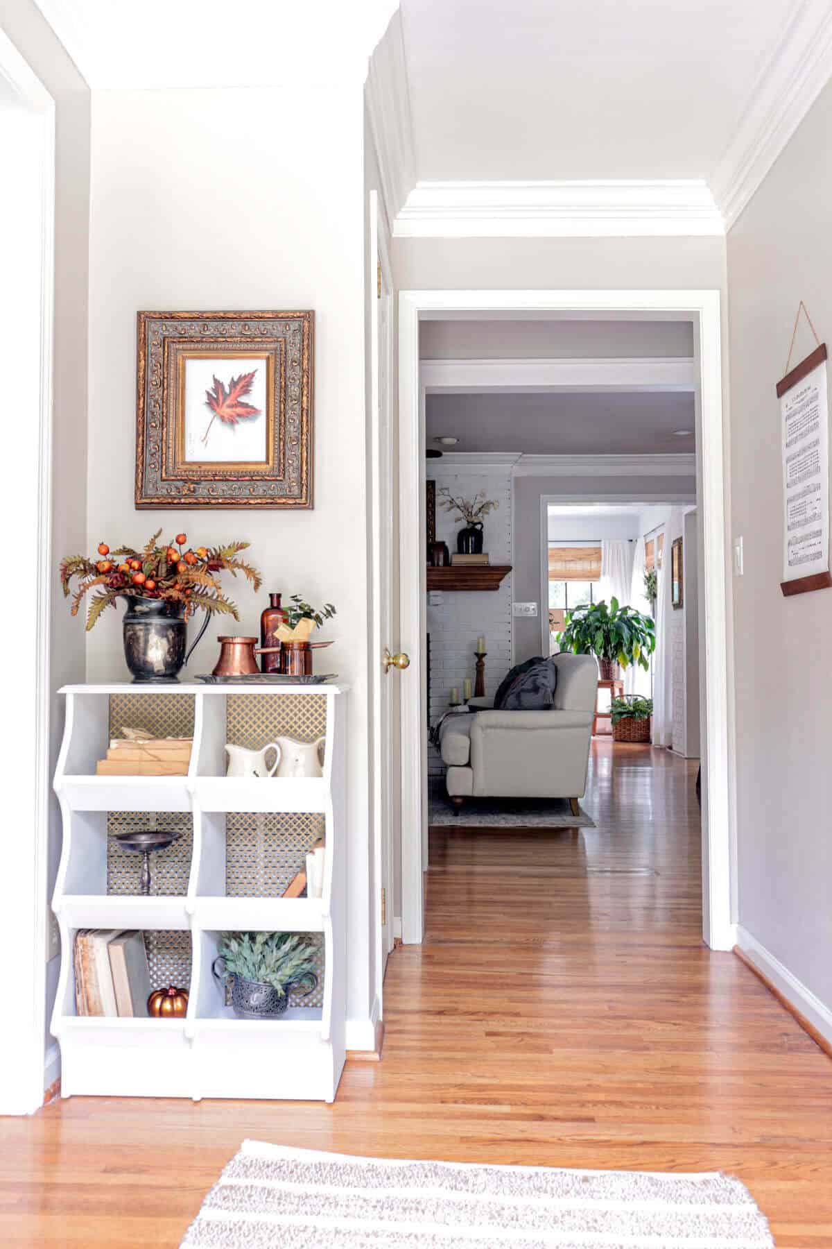 entryway styled for fall with rust and copper
