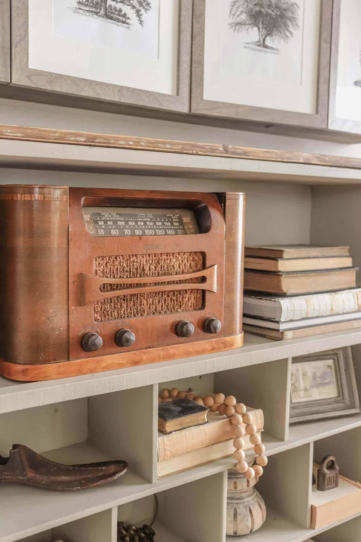 Vintage radio on a shelf with old books