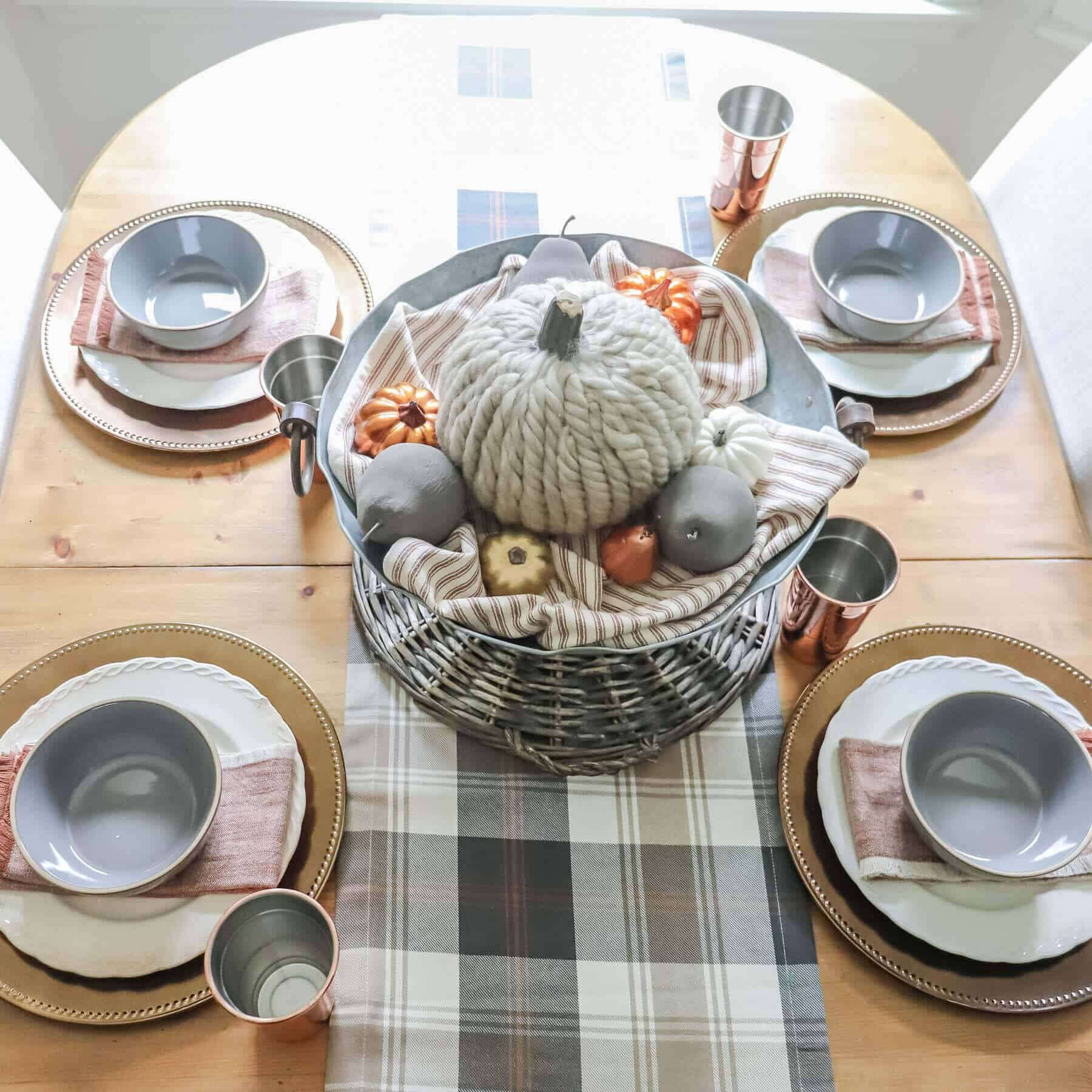 Overhead view fall table with gray tartan plaid and copper elements