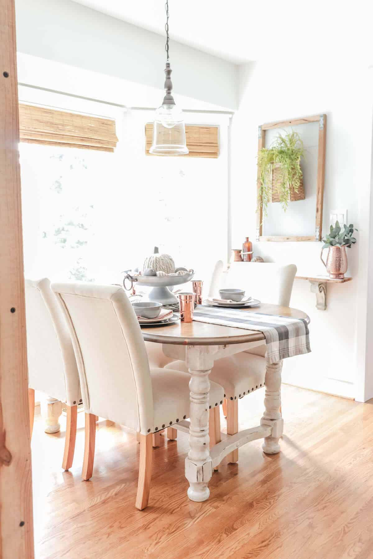 fall table with gray tartan plaid and copper elements