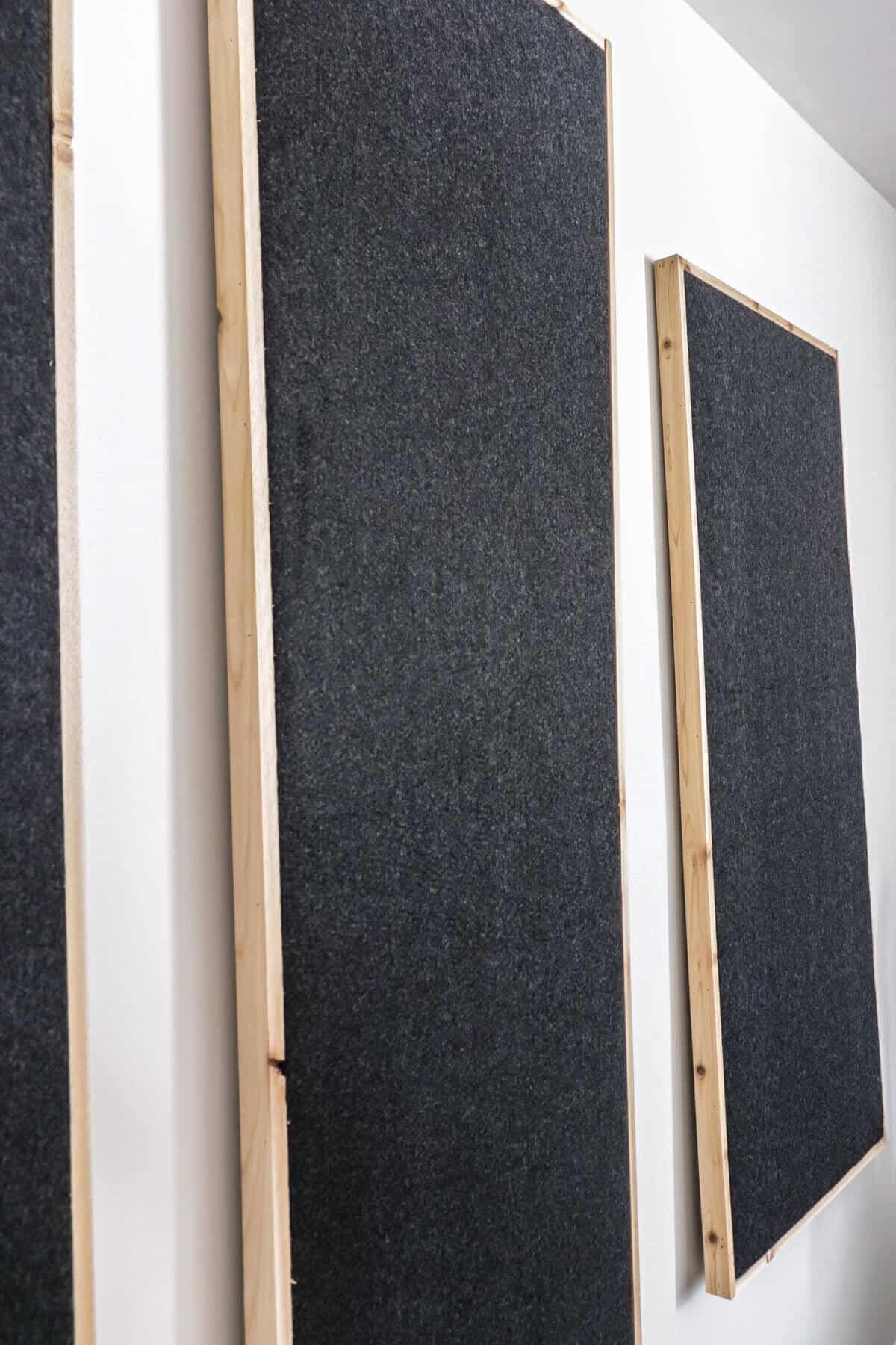 charcoal felt fabric sound panels wrapped in cedar trim