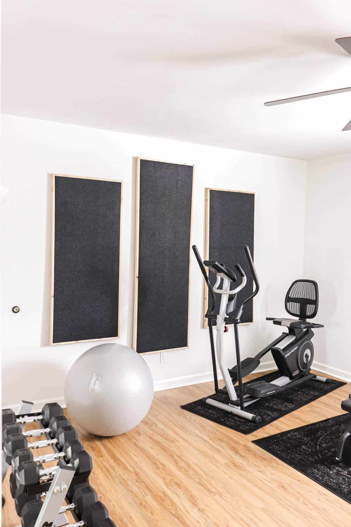 charcoal felt fabric sound panels wrapped in cedar trim on a wall in an exercise room