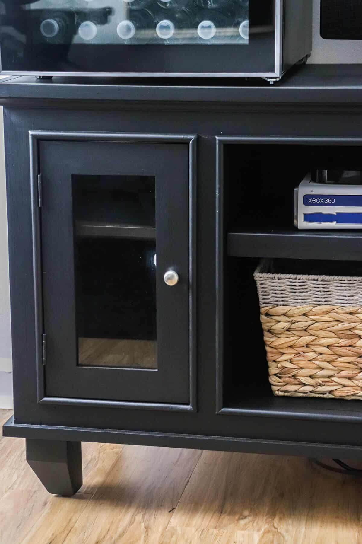 Black painted entertainment center for home gym