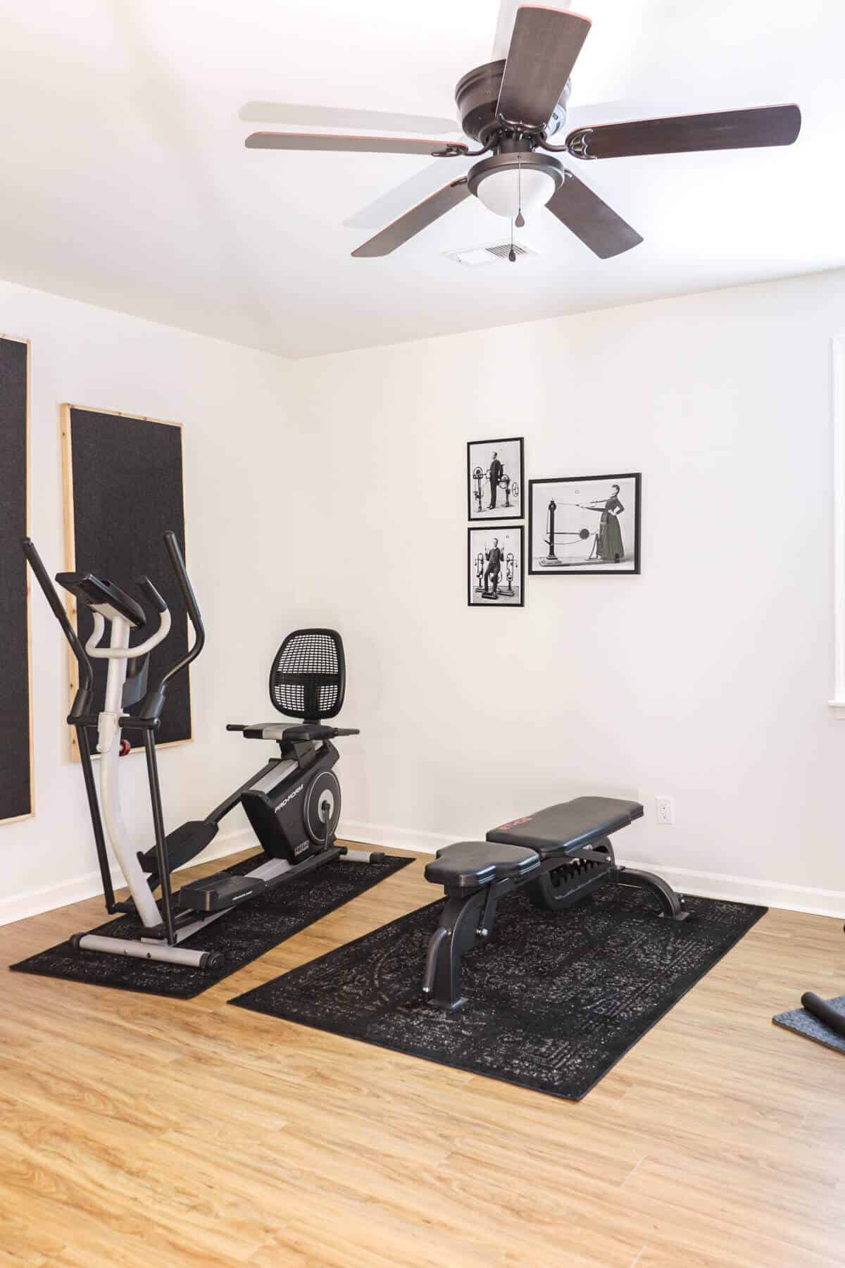 weight bench in a black and white workout room