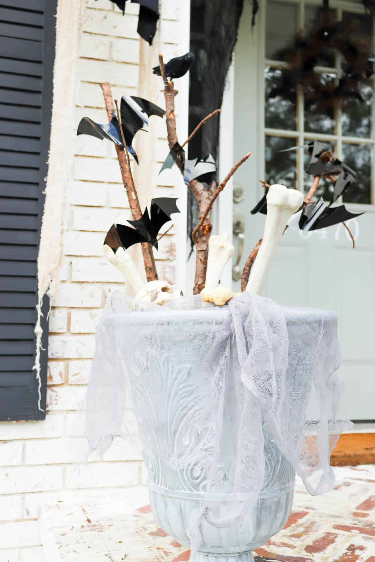 old sticks decorated with fake bats and crows