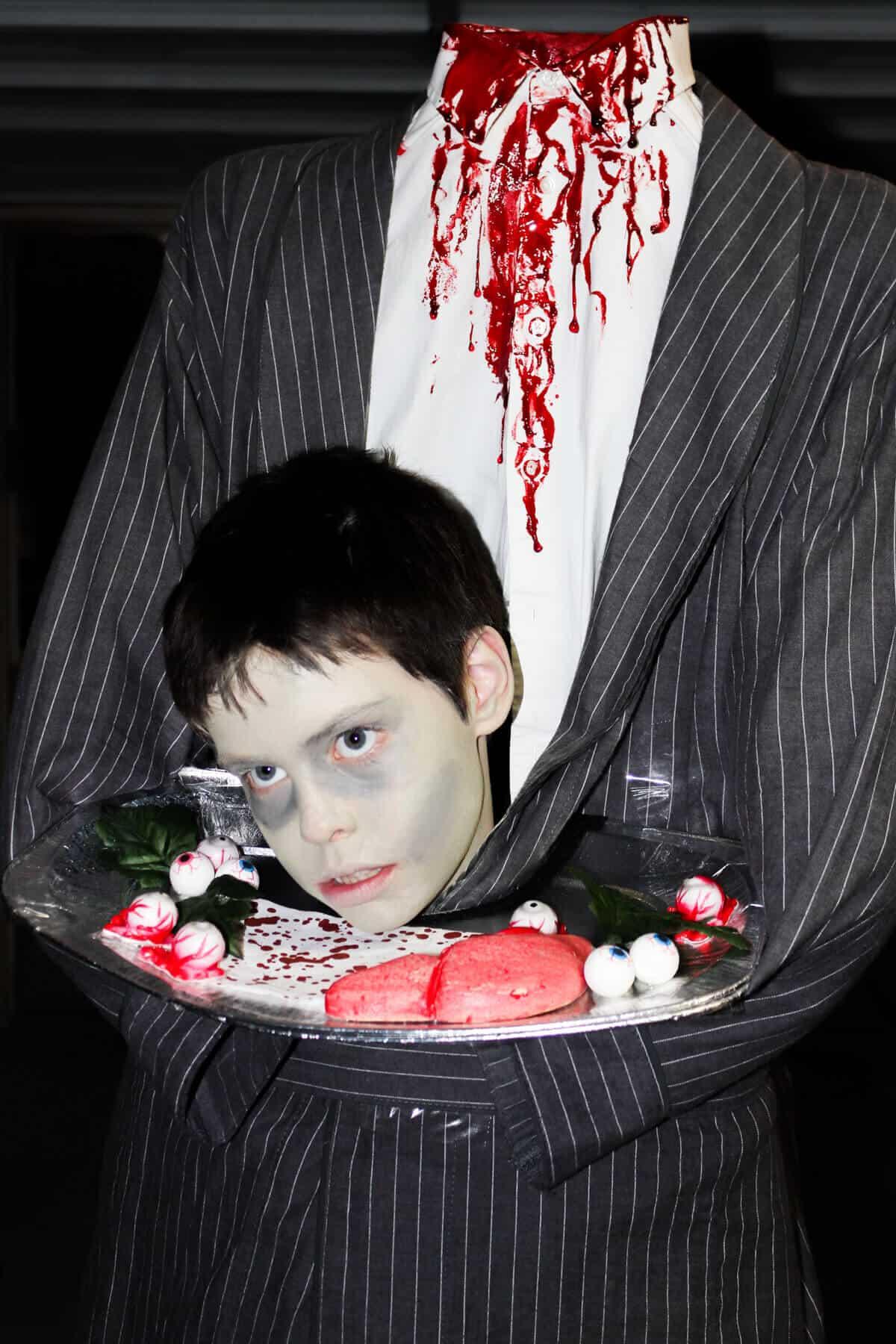 kid costume head on a tray
