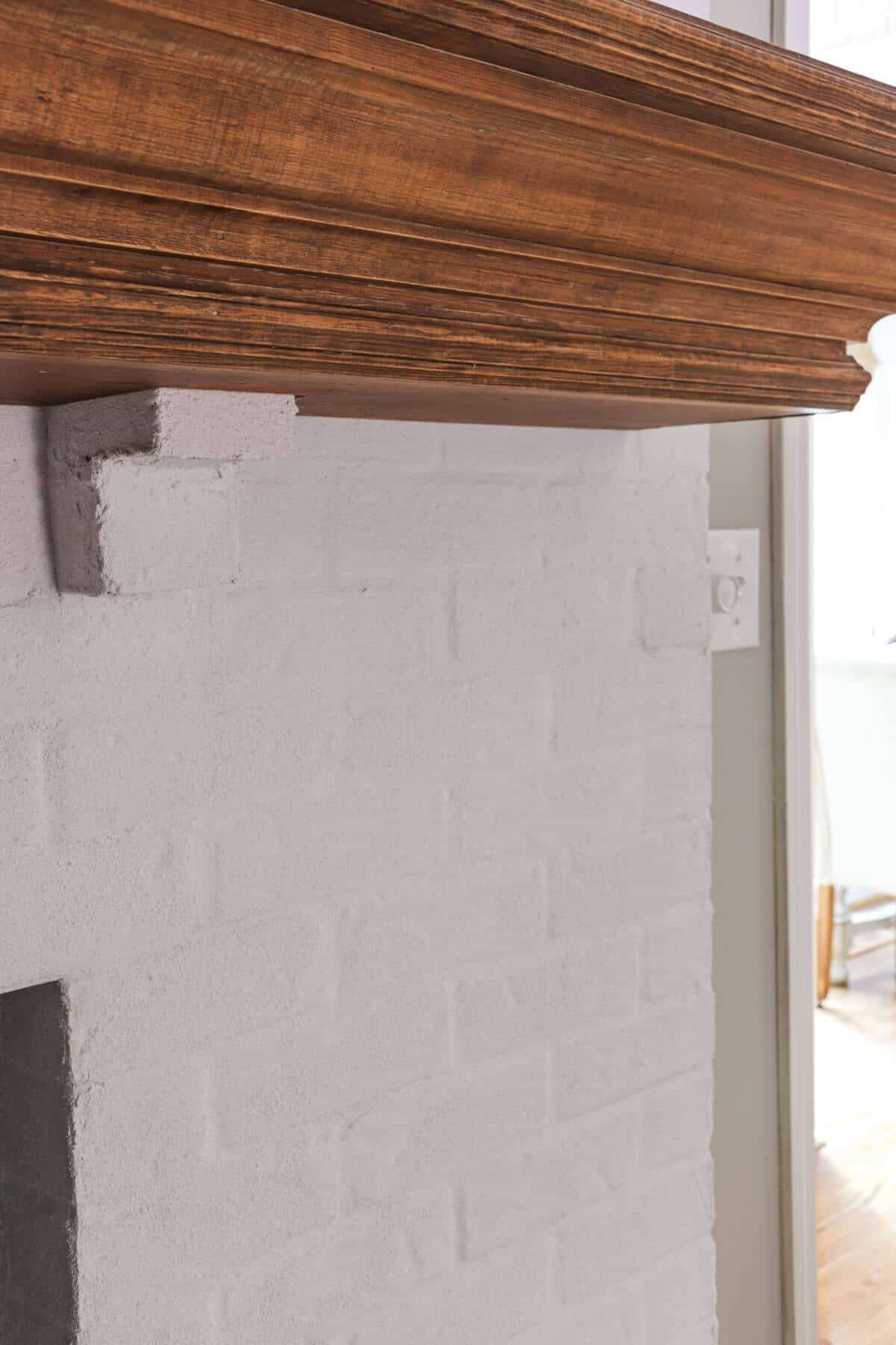 White fireplace with Romabio Lime Slurry in Grace Note