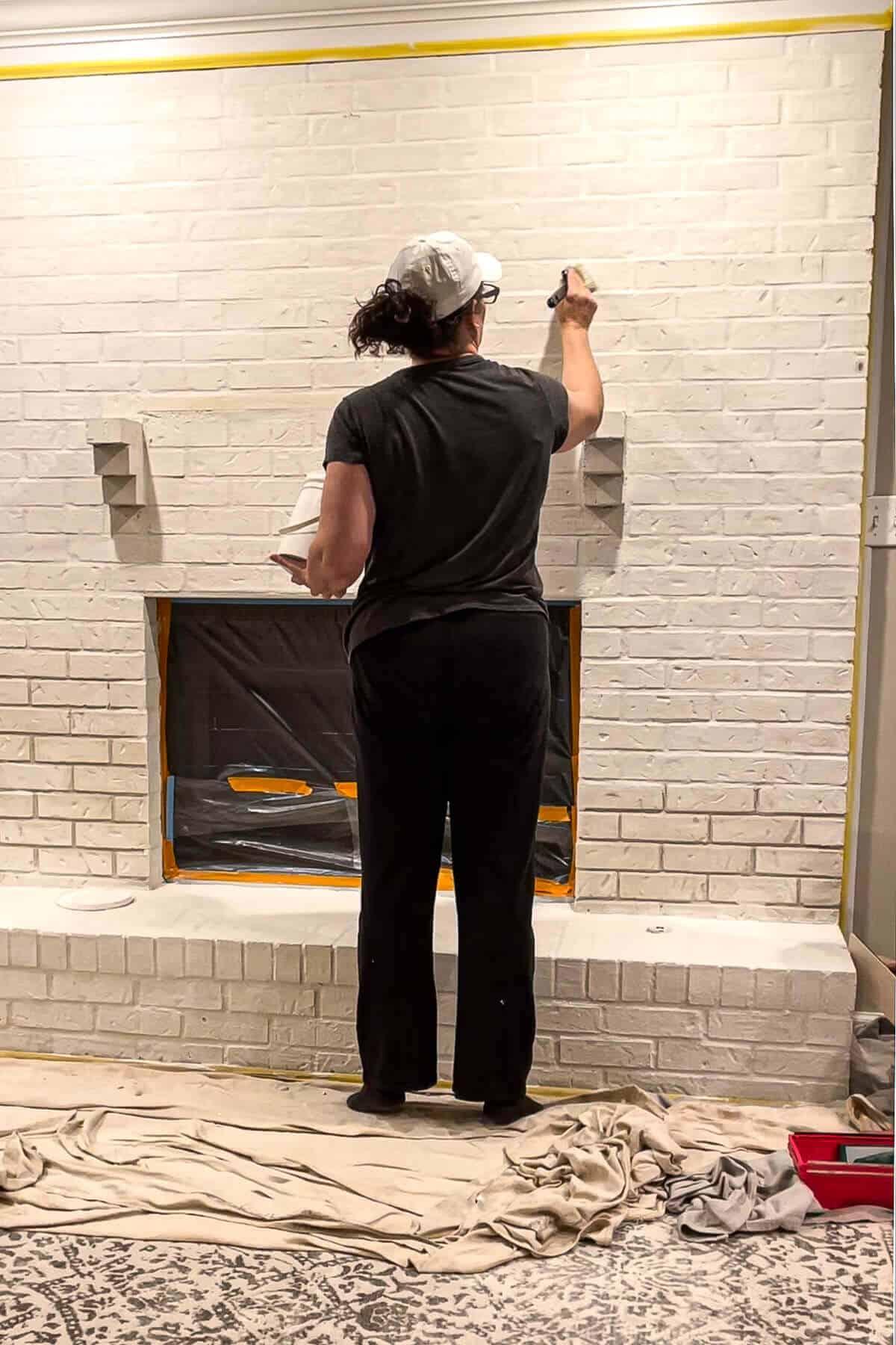 Jen from Noting Grace applying Romabio Marmorino GF to divots in her brick fireplace