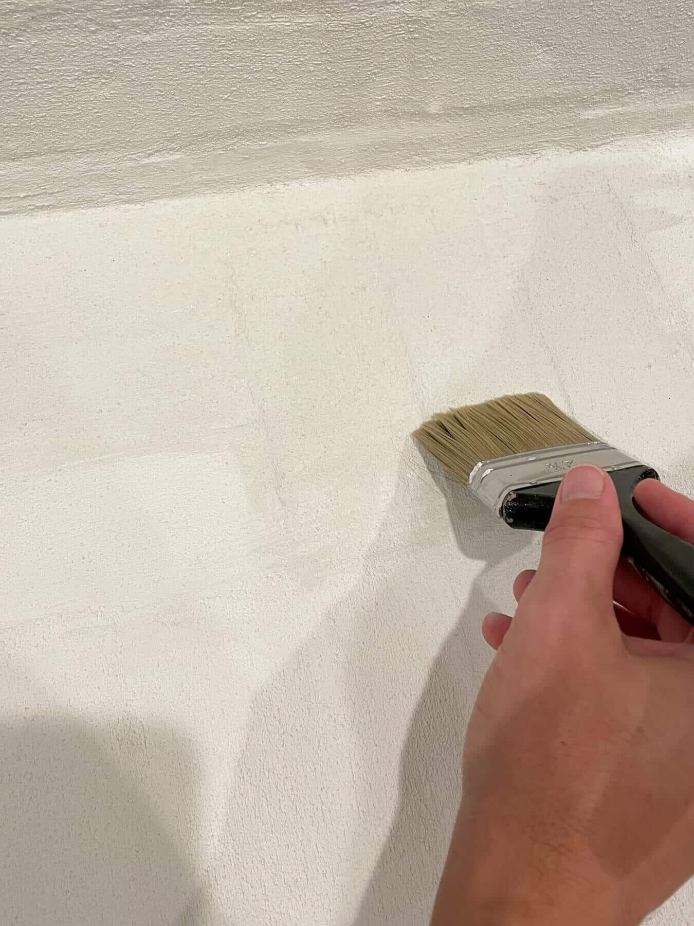 applying Romabio mineral shield to a lime slurry painted fireplace